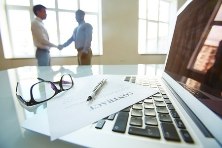 up close: Business people shaking hands on signing a contract