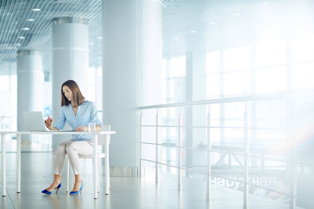 executive women: Pretty young employee working by table