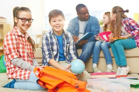 schoolkids: Happy schoolkids looking at camera