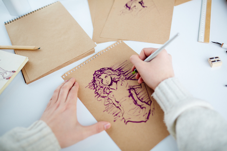 paper art: Picture of young female being drawn by man