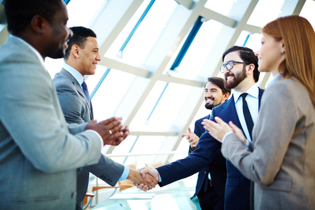 Businessmen congratulating one another after making agreement Stock Photo