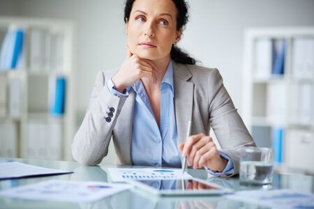 corporate office: Modern businesswoman sitting at workplace Stock Photo