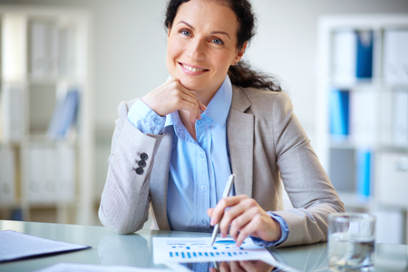 modern businesswoman: Modern businesswoman looking at camera with smile Stock Photo
