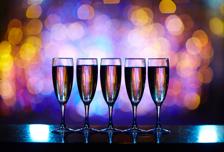 flutes: Several flutes with champagne on bar counter Stock Photo