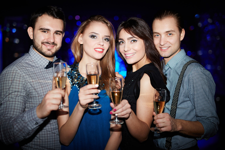 clubber: Group of happy friends with champagne enjoying party Stock Photo