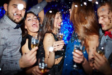 ecstatic: Group of ecstatic people dancing with champagne Stock Photo