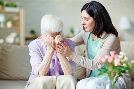 to reassure: Young woman reassuring her mother Stock Photo