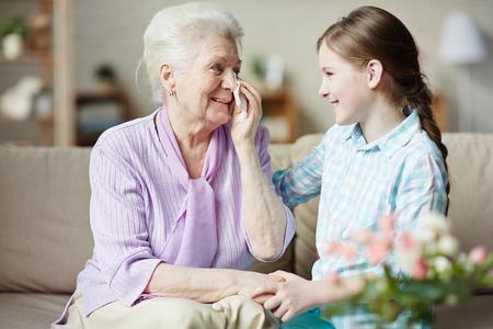 reassuring: Happy teenager reassuring her grandmother