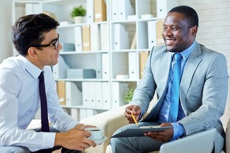 business partners: Business partners talking at office Stock Photo