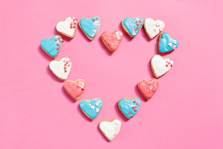 decorated: Heart cookies decorated with glaze isolated on pink background