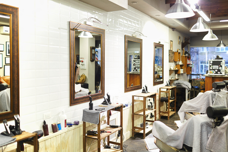 barbershop: Professional equipment, mirrors and seats in modern barbershop