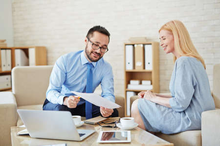 asian business man: Businessman showing contract to partner at meeting