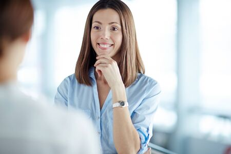 colleague: Smiling businesswoman listening to colleague