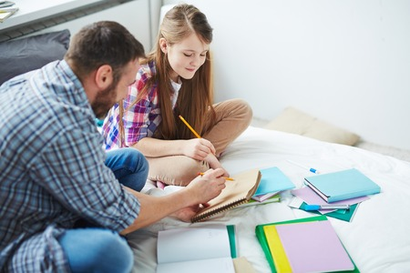 father daughter: Father showing his teenage daughter his drawing