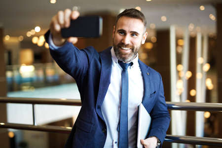 technology career: Happy businessman making his selfie on cellphone Stock Photo