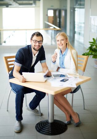 young businessman: Two young colleagues looking at camera at workplace Stock Photo