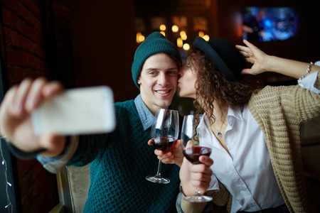 amorous woman: Amorous young couple making selfie in restaurant