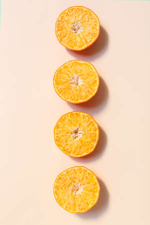 knoll: Chopped orange isolated on pink background