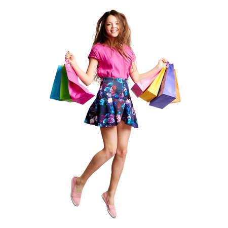 shopper: Energetic young shopper jumping with paperbags