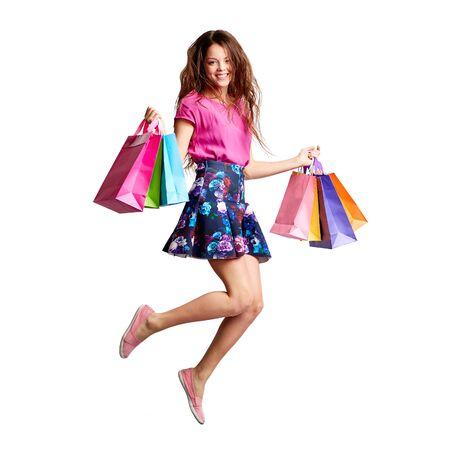 personas saltando: Salto del comprador con bolsas de papel mirando a la cámara Foto de archivo