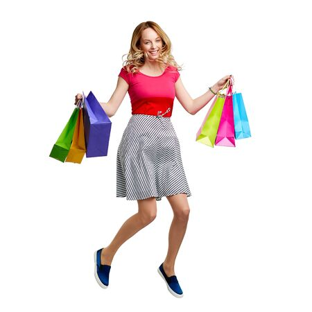 shopper: Ecstatic shopper with paperbags in jump Stock Photo