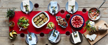 food and wine: Homemade baked potatoes, vegetable salad, ham and pie on dinner table