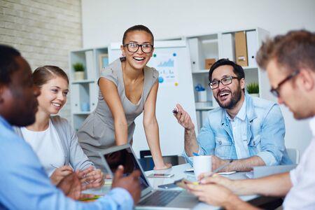 briefing: Joyful colleagues planning work at briefing