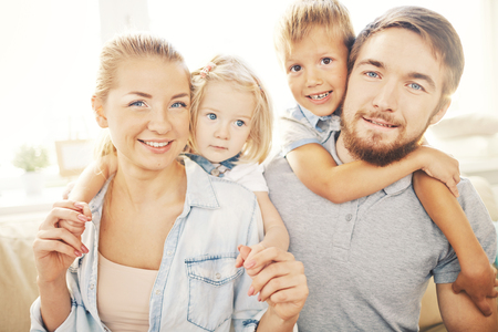 Portrait of a young family with two children Stock Photo