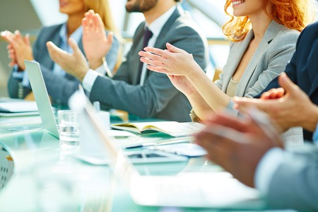 ovation: Business people clapping at conference Stock Photo