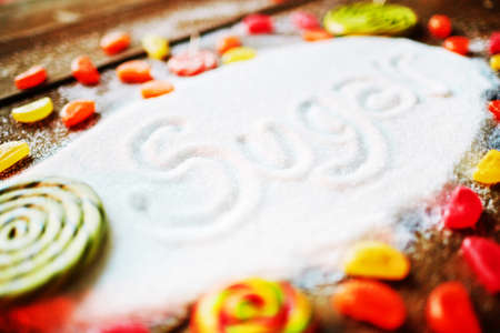 sweettooth: Group of candies around sugar