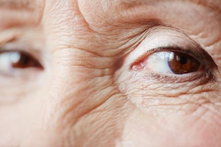 eyelid: Glance of wrinkled senior female Stock Photo
