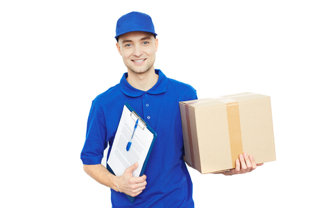 courier: Happy courier with parcel and delivery document looking at camera