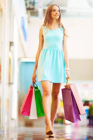 consumer: Pretty young consumer with paperbags