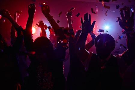 dancing club: Modern young people dancing at disco in night club Stock Photo
