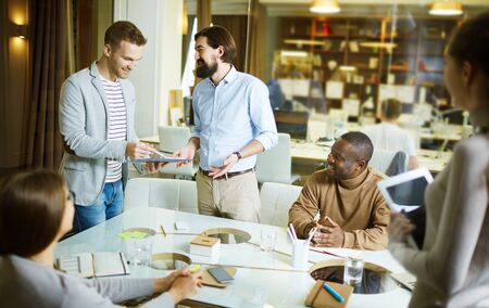 casual office: Men talking during meeting in office