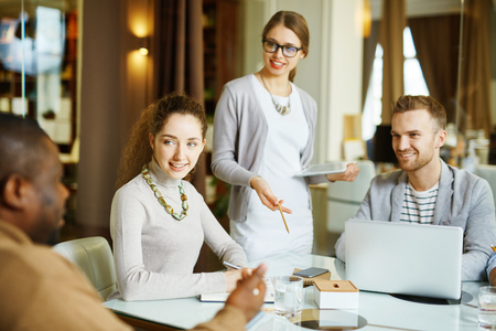 lively: Male and female colleagues discussing lively in office Stock Photo