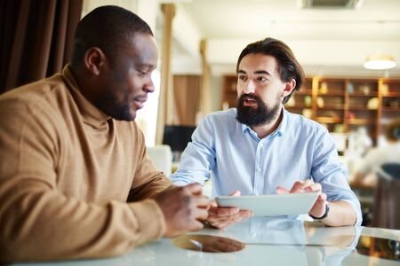 coworker: Businessman talking to his colleague at personal meeting