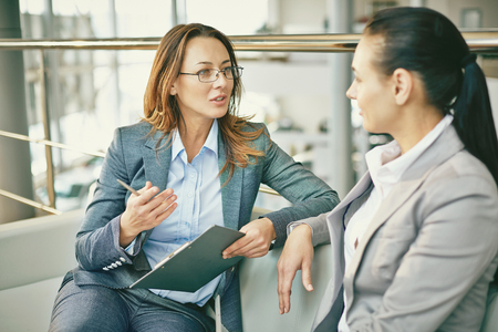Hr manager asking questions to female candidate Stock Photo - 55586162
