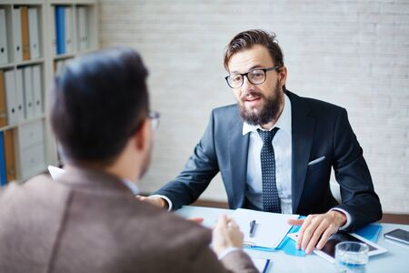 employer: Modern employer hiring people at work