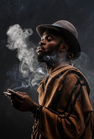 swag: African-american guy smoking in isolation Stock Photo
