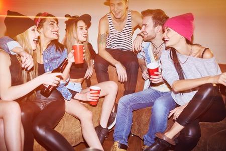swag: Happy swag friends enjoying gathering in night club
