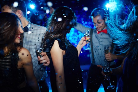 clubber: Group of dynamic young people enjoying party in night club Stock Photo
