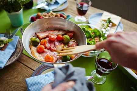 fryingpan: Human frying bacon and vegs on frying-pan
