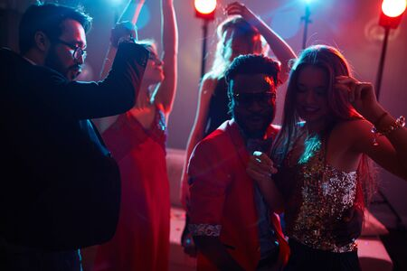 clubber: Multi-ethnic couple dancing at party among their friends