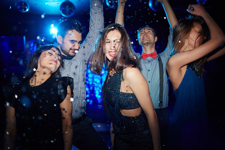 adult entertainment: Ecstatic young woman and her posh dancing in night club Stock Photo