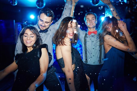 clubber: Posh girls and their boyfriends dancing in night club Stock Photo