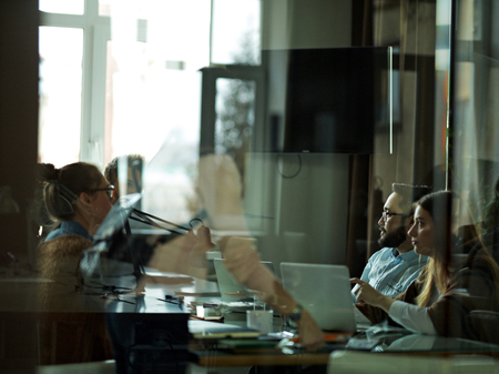 Modern office workers having meeting Stock Photo