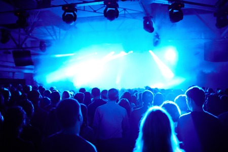 entertainment event: Crowd standing at the stage