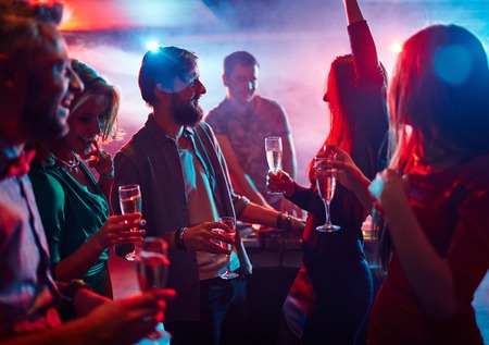clubber: Cheerful friends having good time in night club Stock Photo