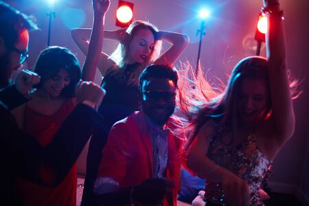 party night: Multi-ethnic dancers enjoying party in night club Stock Photo